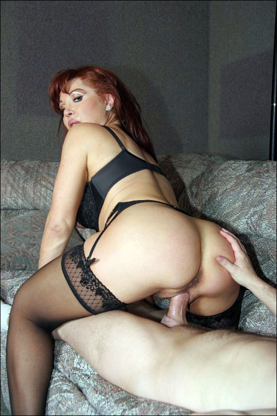 Horny milf stripping down to her black lingerie and then she sucks cock to size him up for a hot and horny fuck session over here